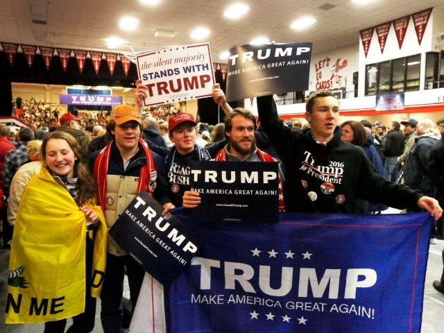 Supporters of Republican presidential candidate Donald Trump cheer as Trump gets ready to speak to a crowd Tuesday, Jan. 5, 2016, in Claremont, N.H.