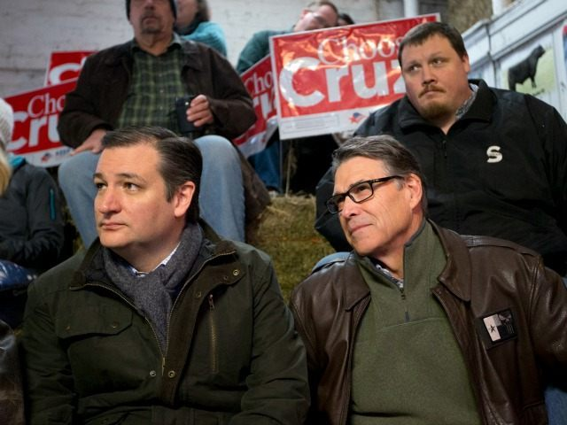 Republican presidential candidate, Sen. Ted Cruz, R-Texas sits with former Texas Gov. Rick Perry at a campaign event at High Point Bulls Oswald Barn, Tuesday, Jan. 26, 2016, in Osceola, Iowa.