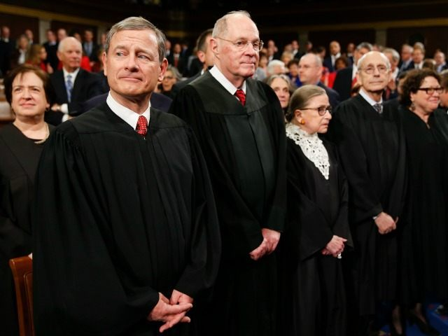 Supreme Court Justice Elena Kagan, from left, Chief Justice John Roberts, Justice Anthony Kennedy, Justice Ruth Bader Ginsburg, Justice Stephen Breyer, and Justice Sonia Sotomayor arrive before President Barack Obama delivers the State of the Union address to a joint session of Congress on Capitol Hill in Washington, Tuesday, Jan. 12, 2016. )