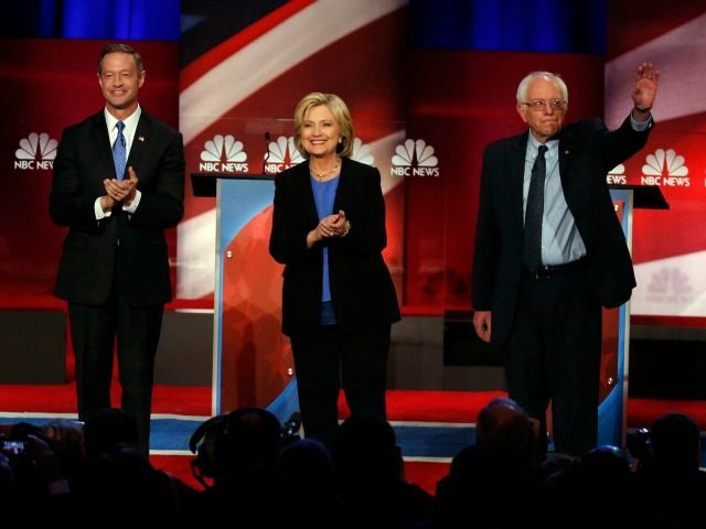 Democratic presidential candidate, former Maryland Gov. Martin O'Malley , left, Democratic presidential candidate, Hillary Clinton and Democratic presidential candidate, Sen. Bernie Sanders, I-Vt, stand together before the start of the NBC, YouTube Democratic presidential debate at the Gaillard Center, Sunday, Jan. 17, 2016, in Charleston, S.C. (