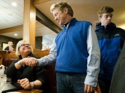 Republican presidential candidate, Sen. Rand Paul, R-Ky, shakes hands with a guest during a campaign stop at the Puritan Backroom restaurant, Friday, Jan. 22, 2016, in Manchester. ()