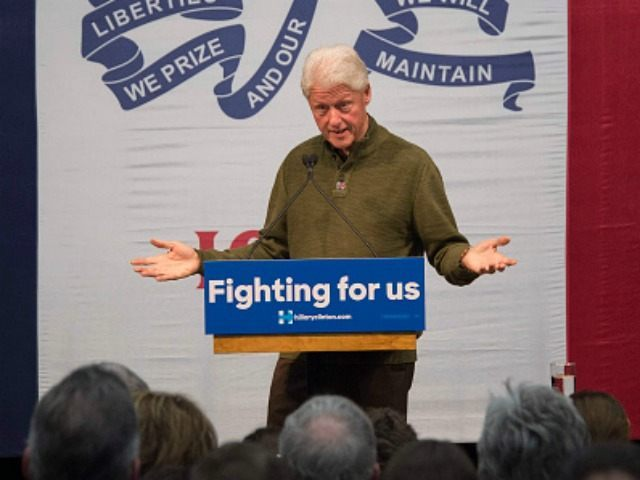 Bill Clinton speaks during a campaign rally for his wife, Democratic presidential candidate Hillary Clinton in Mason City, Iowa, January 27, 2016, ahead of the Iowa Caucus. / AFP / JIM WATSON (Photo credit should read