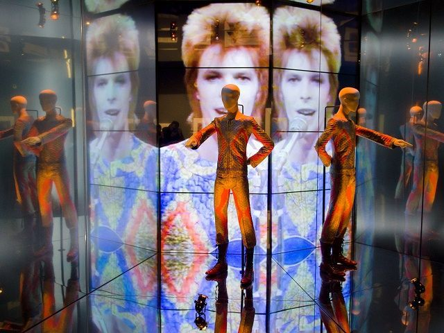 """The """"Starman"""" costume from David Bowie's appearance on """"Top of the Pops"""" in 1972 is displayed at the """"David Bowie is"""" exhibition at the Victoria and Albert (V&A) museum in central London on March 20, 2013. Running March 23 to August 11, the exhibition features more than 300 objects that …"""
