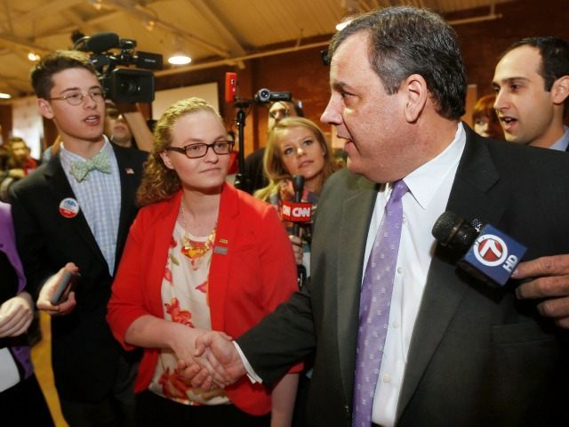 Republican presidential candidate, New Jersey Gov. Chris Christie shakes hands with students during a campaign stop at a college student convention, Tuesday, Jan. 5, 2016, in Manchester, N.H.