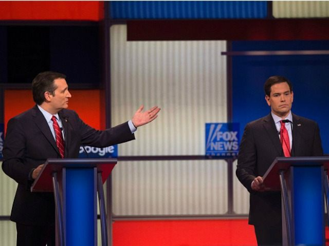 Florida Senator Marco Rubio (R) looks on Texas Senator Ted Cruz speaks during the Republican Presidential debate sponsored by Fox News at the Iowa Events Center in Des Moines, Iowa on January 28, 2016. / AFP / AFP PHOTO / Jim WATSON (Photo credit should read