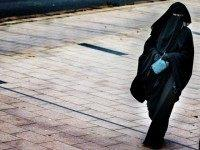A woman wearing a burqa walks in The Hague on December 1, 2014. The Dutch cabinet approved on May 22, 2015 a partial ban on wearing the face-covering Islamic veil, including in schools, hospitals and on public transport. AFP PHOTO / ANP PHOTO / FILER JERRY LAMPEN netherlands out (Photo …