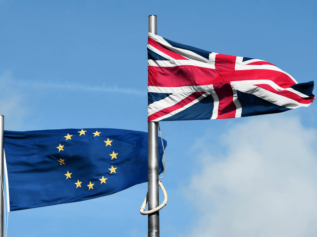 The European union and Union flag fly outside the national assembly building in Cardiff on September 24, 2015.