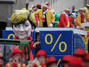COLOGNE, GERMANY - FEBRUARY 20: A carnival float showing german chancellor Angela Merkel accompanies in the Rose Monday parade on February 20, 2012 in Cologne, Germany. Rose Monday is the highpoint of the Carnival season, which traditionally runs from Epiphany until Ash Wednesday, and is celebrated in cities throughout the Rhine region of western Germany. (Photo by Dennis Grombkowski/Getty Images)