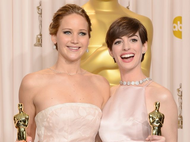 HOLLYWOOD, CA - FEBRUARY 24: (L-R) Actresses Jennifer Lawrence and Anne Hathaway pose in the press room during the Oscars held at Loews Hollywood Hotel on February 24, 2013 in Hollywood, California. (Photo by Jason Merritt/Getty Images)