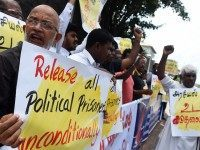 Sri Lankan activists demanding the release of Tamil detainees held in custody for long periods without trial demonstrate outside the main prison in Colombo on October 16, 2015. The prisoners were arrested during Sri Lanka's 37-year civil war for suspected involvement with Tamil rebels fighting for a separate homeland for …