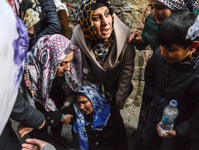 Relative cry after a woman died at her home when a mortar hit it during a clashes at Sur district in Diyarbakir, on January 3, 2016. Tensions are running high throughout Turkey's restive southeast as security forces impose curfews in several towns including Cizre in a bid to root out …