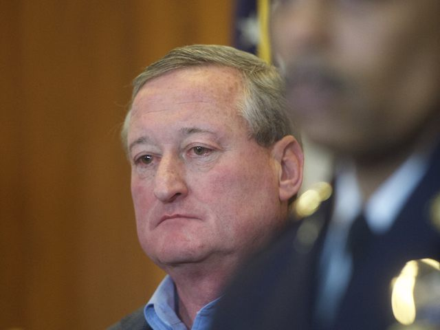 PHILADELPHIA, PA - JANUARY 8: Philadelphia Mayor Jim Kenney listens to Police Commissioner Richard Ross address media at a press conference regarding the shooting of Police Officer Jesse Hartnett, 33, who was ambushed and allegedly shot at 13 times by Edward Archer, 30, last night on January 8, 2016 in …