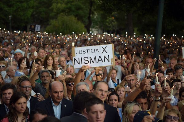 People hold candles during a vigil on the first anniversary of Argentinian prosecutor Alberto Nisman's mysterious death in Buenos Aires, on January 18, 2016. The prosecutor died in mysterious circumstances in January 18, 2015, after accusing Argentina's then president, Cristina Fernandez de Kirchner, of obstructing his investigation of a 1994 bombing at a Buenos Aires Jewish center. AFP PHOTO/EITAN ABRAMOVICH. / AFP / EITAN ABRAMOVICH (Photo credit should read EITAN ABRAMOVICH/AFP/Getty Images)