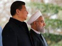 Iranian President Hassan Rouhani and Chinese President Xi Jinping (L) take part in a welcoming ceremony on January 23, 2016 in the capital Tehran.  Chinese President Xi Jinping arrived on January 22, 2016 in Iran on the third leg of a Middle East tour aimed at boosting economic ties with the region. State news agency IRNA said Xi, accompanied by three deputy premiers and six ministers as well as a high-ranking business delegation, was greeted at Tehran airport by Iranian Foreign Minister Mohammad Javad Zarif.   / AFP / STR        (Photo credit should read STR/AFP/Getty Images)