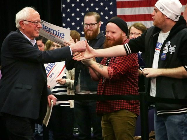 WATERLOO, IA - JANUARY 31: Democratic presidential candidate Sen. Bernie Sanders (I-VT) (L) greets supporters as he arrives at a campaign event at Five Sullivan Brothers Convention Center January 31, 2016 in Waterloo, Iowa. Sanders continues to seek support for the Democratic nomination prior to the Iowa caucus on February …