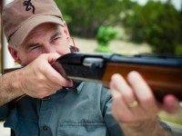 Greg Abbott with Shotgun