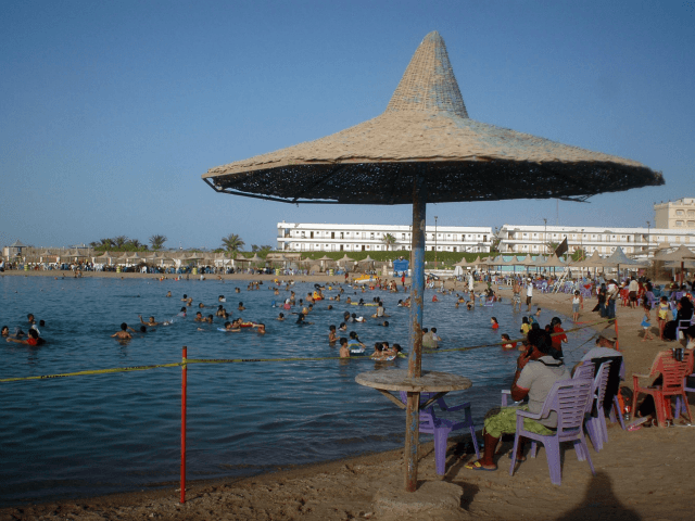 Egyptians enjoy the public beach along the Red Sea resort of Hurghada, in southern Egypt, on June 23, 2010, which attacks hundreds of thousands of tourists all year round.