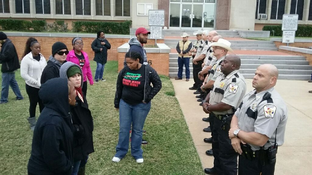 Two dozen protesters faced off against Waller County sheriff's deputies following the announcement of the misdemeanor perjury indictment against DPS Trooper Brian Encinia. (Photo Courtesy of Isiah Carey, Fox 26 News)
