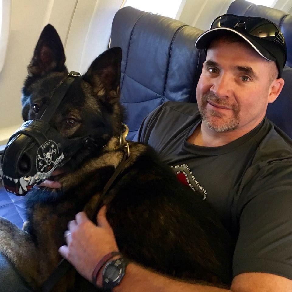 Davis and his new K9 partner Tuko flying home. (Photo: K9s4COPS)