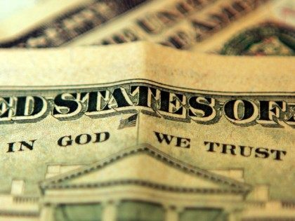 "LONDON, UNITED KINGDOM - OCTOBER 23: In this photo illustration the phrase ""In God We Trust"" can be seen on an American ten dollar bill on October 23, 2008 in London, England. The British pound has hit it's lowest point against the Dollar in five years as it fell to …"