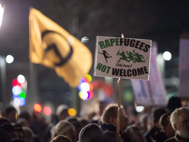 LEIPZIG, GERMANY - JANUARY 11: Supporters of the right-wing populist group Pegida march on the first anniversary of its Leipzig affiliate, called Legida, on January 11, 2016 in Leipzig, Germany. Pegida and other right-wing activists have been quick to latch on to the New Year's Eve sex attacks in Cologne. …