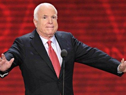 McCain arms spread AP J. Scott Applewhite