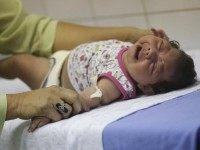 Hospital staff Oswaldo Cruz prepares to draw blood from baby Lorrany Emily da Silva, who has microcephaly, at the Oswaldo Cruz Hospital in Recife, Brazil
