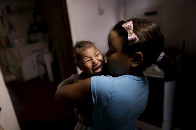 Camile Vitoria embraces her brother Matheus, who has microcephaly, in Recife, Brazil