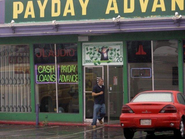 Payday loans (Lenny Ignelzi / Associated Press)