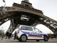 This photo taken on November 14, 2015 shows a police car stationed next to the Eiffel Tower in Paris.
