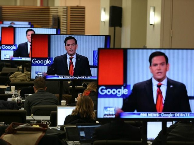 Republican Presidential candidate Sen. Sen. Marco Rubio (R-FL) is seen on television screens as reporters watch the Republican Presidential debate sponsored by Fox News and Google at the Iowa Events Center on January 28, 2016 in Des Moines, Iowa. The Democratic and Republican Iowa Caucuses, the first step in nominating …
