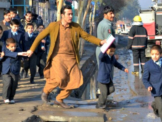 Running from site of clash in Jalalabad AP