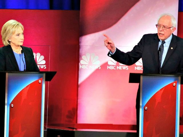 Democratic presidential candidate, Sen. Bernie Sanders, I-Vt., gestures towards Democratic presidential candidate, Hillary Clinton during the NBC, YouTube Democratic presidential debate at the Gaillard Center, Sunday, Jan. 17, 2016, in Charleston, S.C. (AP Photo/Mic Smith)