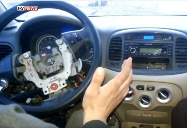 A terrorist shows off the remote car.
