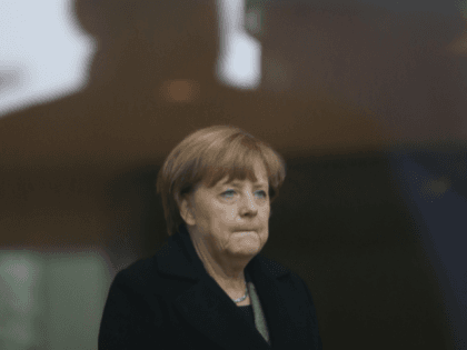 German Chancellor Angela Merkel worried / sad