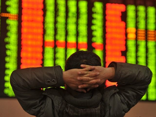 An investor sits in front of a screen showing stock market movements in a stock firm in Fuyang, east China's Anhui province on January 4, 2016. Trading on the Shanghai and Shenzhen stock exchanges was ended early on January 4 after shares fell seven percent, the first time China's new …