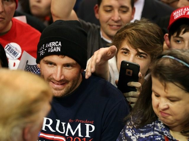 Supporters of the Republican presidential frontrunner Donald Trump try to get autographs after his appearance at the Mississippi Coast Coliseum on January 2, 2016 in Biloxi, Mississippi. Trump, who has strong support from Southern voters, spoke to thousands in the small Mississippi city on the Gulf of Mexico. Trump continues to split the GOP establishment with his populist and controversial views on immigration, muslims and some of his recent comments on women. (Photo by