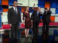 2016 Republican presidential candidates Rick Santorum, former senator, from left, Carly Fiorina, former chairman and chief executive officer of Hewlett-Packard Co., Mike Huckabee, former governor of Arkansas, and Jim Gilmore, former governor of Virginia, arrive to participate in the Republican presidential candidate debate in Des Moines, Iowa, Jan. 28, 2016.