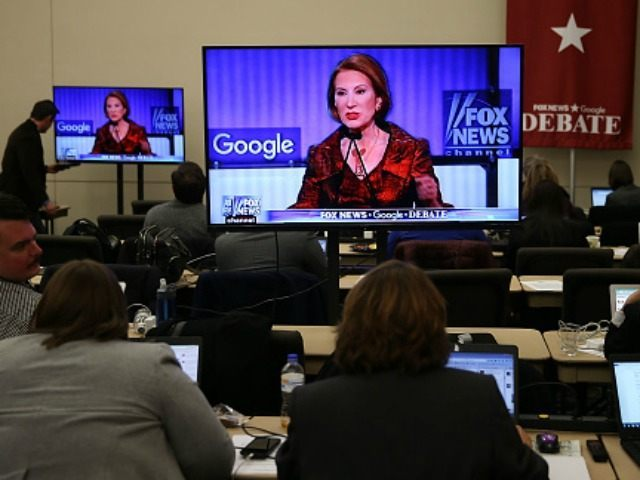 Republican Presidential candidate Carly Fiorina is seen on a television screen as reporters watch the debate during the Republican Presidential debate sponsored by Goggle and Fox News at the Iowa Events Center on January 28, 2016 in Des Moines.