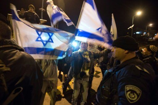 Israeli settlers protest outside their settlement of Kiryat Arba in the southern West Bank after a suspected Palestinian attacker stabbed to death a woman at her home in the Otniel settlement
