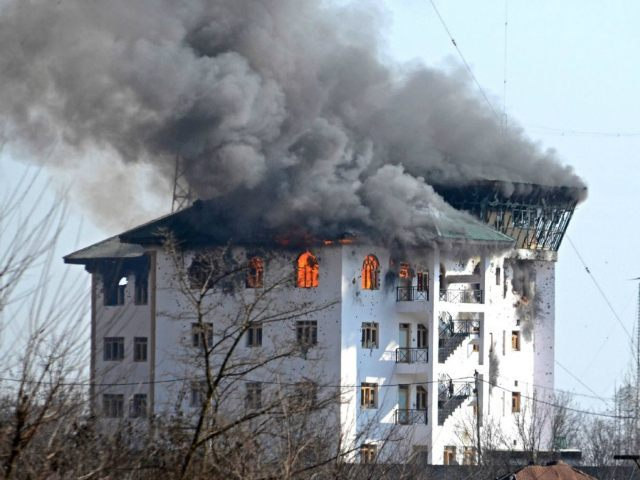 INDIA, KASHMIR : PAMPORE, KASHMIR-INDIA FEBRUARY 22: Fire engulfs government building after it was blasted by Indian army where suspected militants were believed to be holed up Pampore some 15 kilometers from Srinagar the summer capital of Indian controlled Kashmir on February 22, 2016.Nine persons including two Indian army captains, three CRPF soldiers, three militants and a civilian were killed when suspected militants attacked a military convoy on Srinagar National highway near Pampore, the militants then took refuge in a nearby government building where a fierce gunbattle between government forces and militants took place, Indian army said. Faisal Khan / Anadolu Agency