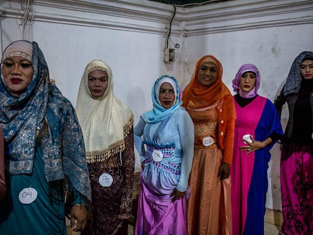 YOGYAKARTA, INDONESIA - AUGUST 12: Members of a boarding school, Al-Fatah, for transgender people known as 'waria', stand as prepare for their muslim fashion contest during Syawalan tradition on August 12, 2015 in Yogyakarta, Indonesia. Syawalan tradition is recognized by the Javanese community as a part of religious traditions as celebrates after the Eid al-Fitr, as all sins forgiven to get back into the pure and clean. During the Syawalan tradition the 'waria' community gather to celebrates. 'Waria' is a term derived from the words 'wanita' (woman) and 'pria' (man). The Koran school Al-Fatah was set back last year's by Shinta Ratri at her house as a place for waria to pray, after their first founder Maryani died. The school operates every Sunday. Islam strictly segregates men from women when praying, leaving no-where for 'the third sex' waria to pray before now. (Photo by Ulet Ifansasti/Getty Images)