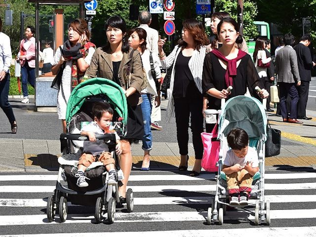 Japanese women push baby carts in Tokyo on October 2, 2015. Spending among Japanese households rebounded in August, offering a glimmer of hope after a string of weak figures, but economists warned the world's number three economy was still headed for recession. While Japan's jobless rate edged up to 3.4 …