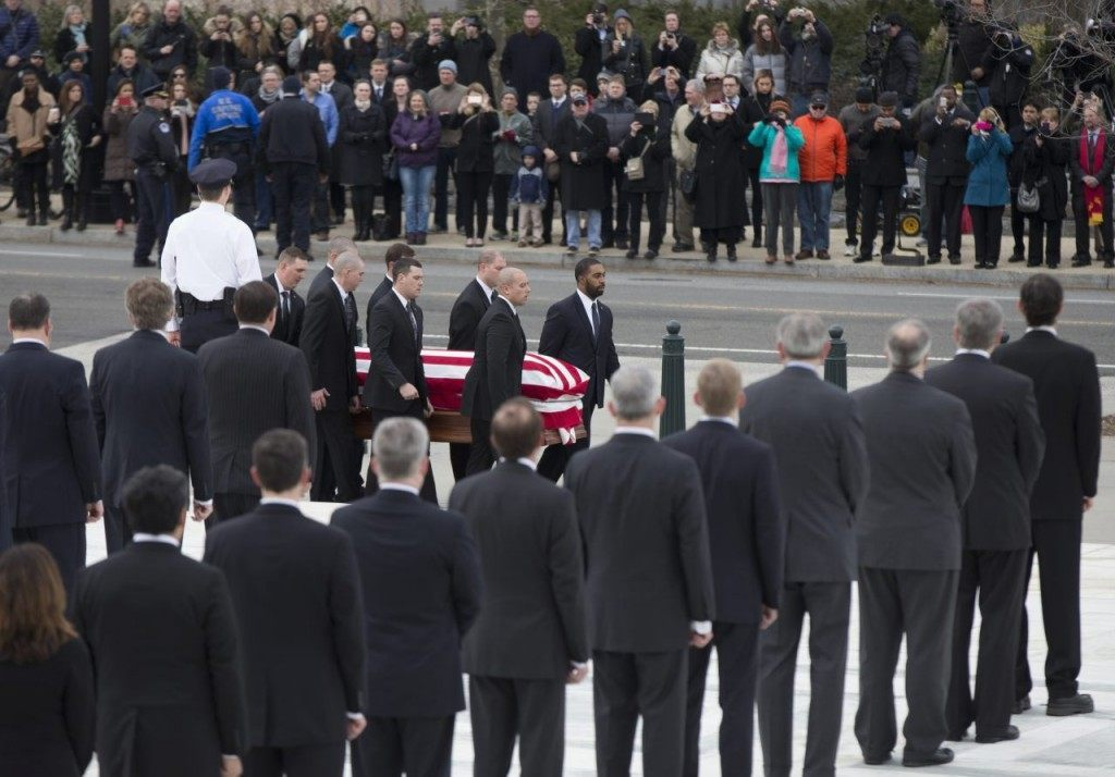 Pallbearers carry the flag-draped casket containing the body of Justice Antonin Scalia into the upreme Court in Washington, Friday, Feb. 19, 2016. Thousands of mourners will pay their respects Friday for Justice Antonin Scalia as his casket rests in the Great Hall of the Supreme Court, where he spent nearly three decades as one of its most influential members. (AP Photo/Manuel Balce Ceneta)