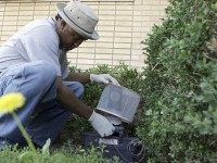 Byron Chism, a mosquito technician with Dallas County, sets a mosquito trap to capture subjects for testing in Dallas, Friday, May 11, 2007. With the arrival of spring rainstorms and steamy weather, mosquito-control workers in Texas and across the nation are gearing up for another round in their battle against …
