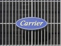 An air conditioner bears the Carrier logo in Omaha, Neb., Tuesday, April 21, 2009. United Technologies Corp. said Tuesday its first-quarter profit fell 28 percent as the industrial conglomerate coped with falling orders related to the drop in office and residential construction. Declines were led by Carrier, with profit plunging …