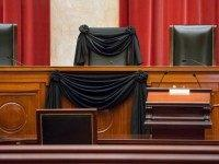 Supreme Court Justice Antonin Scalia's courtroom chair is draped in black to mark his death as part of a tradition that dates to the 19th century, Tuesday, Feb. 16, 2016, at the Supreme Court in Washington. Scalia died Saturday at age 79. He joined the court in 1986 and was its longest-serving justice.