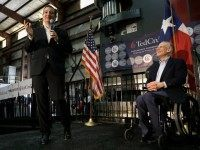 Republican presidential candidate, Sen. Ted Cruz, R-Texas, accompanied by Texas Gov. Greg Abbott, speaks during a rally, Wednesday, Feb. 24, 2016, in Houston.