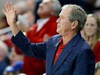 Former President George W. Bush waves to the crowd, December 2015.