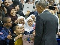 President Barack Obama stops to greets children from Al-Rahmah school and other guests during his visit to the Islamic Society of Baltimore, Wednesday, Feb. 3, 2016, in Baltimore, Md. Obama is making his first visit to a U.S. mosque at a time Muslim-Americans say they're confronting increasing levels of bias …